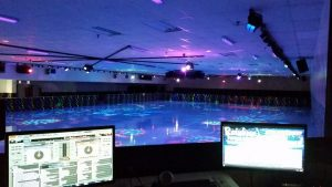 View from DJ booth of skating rink under colorful lights