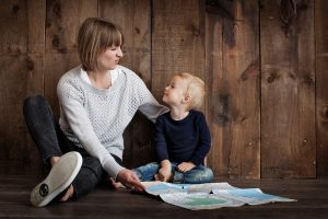 Mom and toddler son with map