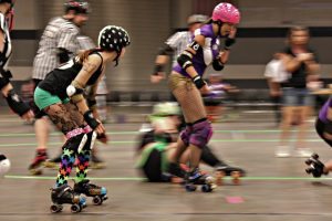 Women playing roller derby