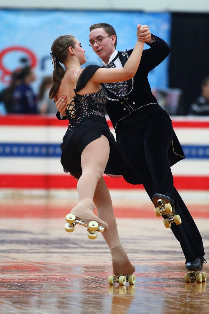 a man and a woman figure roller skating