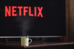 Mug of warm drink sitting in front of TV with Netflix