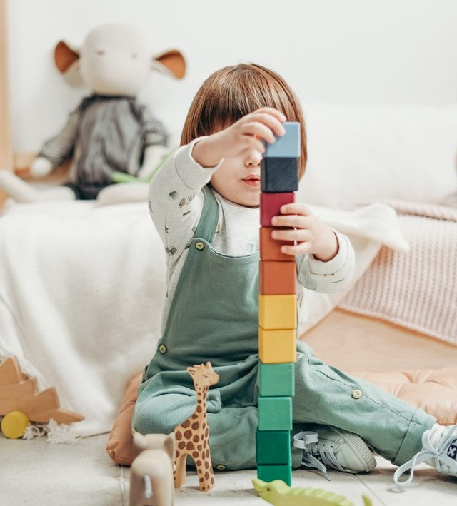 Small child playing with blocks