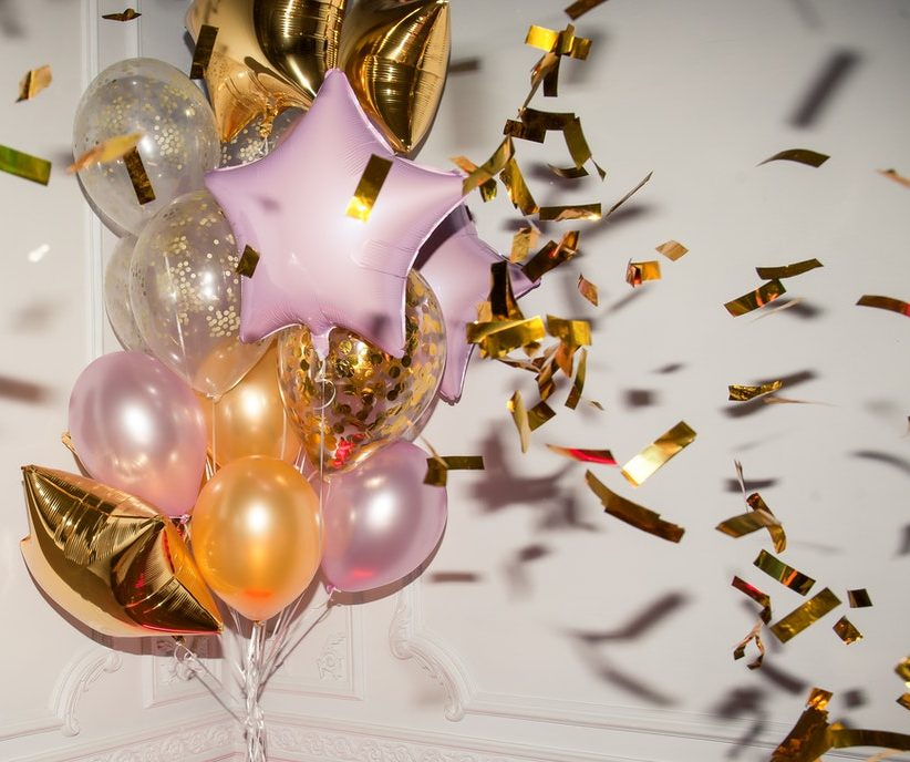 Trendy metallic birthday balloons and confetti