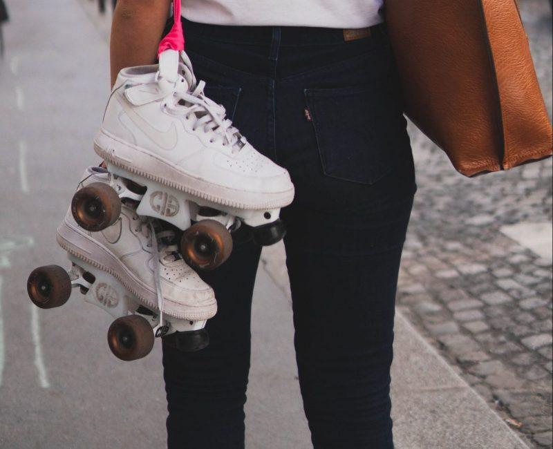 Worn out roller skate wheels on white skates